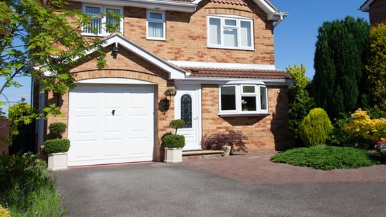 A home with a new tarmac driveway